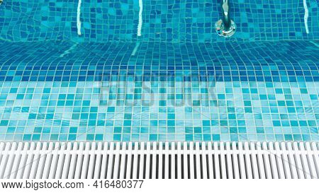 Top View Of Empty Pool With Hydro Massage In Swimming Pool With Blue Mosaic Tiles And Drain Bars. Tr