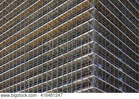 Huge Scaffolding Covering The Facade Of A Tall Building