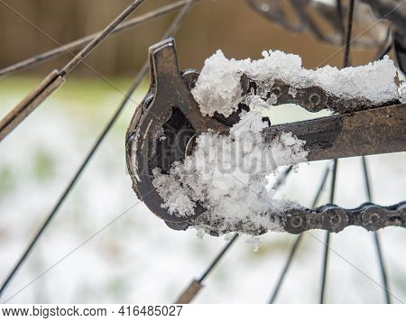 Snowy And Dirty Lubricated Rear Rail Derailleur. Detail Of Icy Pulley Of Mountain Bike Gears With Sp