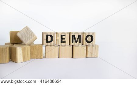Demo Symbol. Concept Word 'demo' On Wooden Cubes On A Beautiful White Background. Business And Demo
