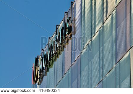 Rotkreuz, Zug, Switzerland - 28th March 2021 : Side View Of Novartis Sign Hanging At The Building In