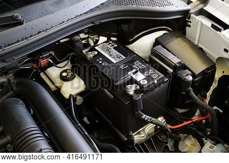 Moscow Russia - April 08 2021: The Battery Is Installed In The Engine Compartment Of A Modern Car.