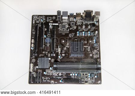 Computer Motherboard With Microcircuits Capacitors Resistors Loops Isolated On A White Background, R