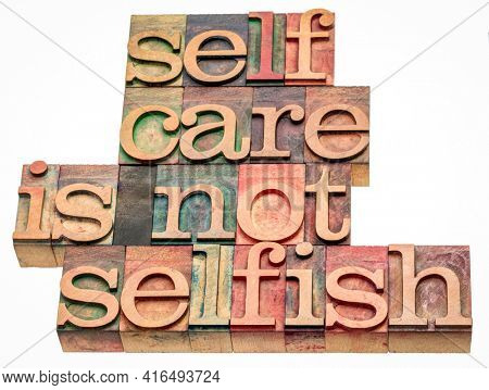 self care is not selfish  - isolated word abstract in vintage letterpress wood type, lifestyle and personal development