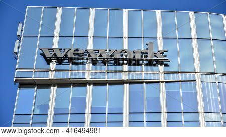 Warsaw. Poland. 11 April 2021. Sign  Wework. Company Signboard Wework.
