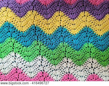 Colorful Yarn In Zigzag Rainbow Crochet Pattern Background
