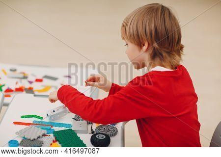 Little Boy Kid Child Constructor Checking Technical Toy. Children Robotics Constructor Assemble Toy