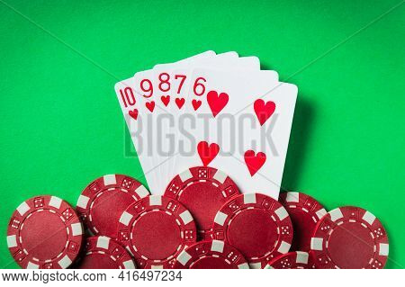 A Winning Poker Combination Is A Straight Flush. Chips And Cards On The Green Table In The Poker Clu
