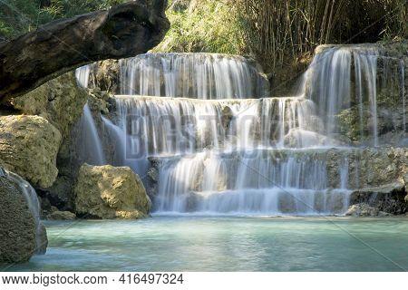 Beautiful Slow Motion Blur Of Running Water At Tat Kuang Si Waterfall, Luang Prabang, Laos.