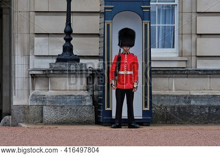 London, Great Britain - May 21, 2018 : Close Up A Royal Guard Standing In Front Of The Buckingham Pa