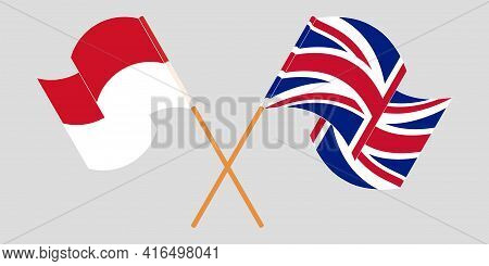 Crossed And Waving Flags Of Indonesia And The Uk