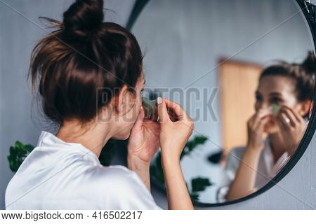 Young Woman Takes Care Of Her Facial Skin At Home
