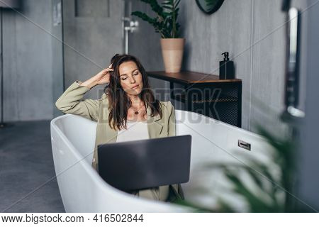 Woman Secluded At Home In The Bathtub And Works