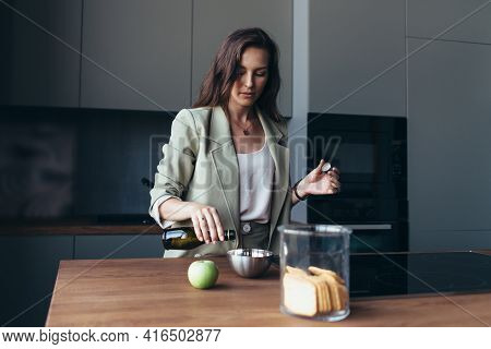 Woman Having Breakfast Before Leaving For Work.