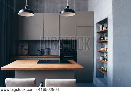 Modern Kitchen With Table And Built-in Hob.