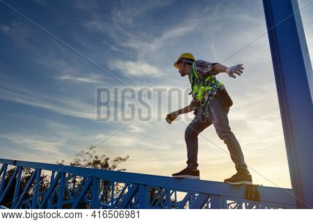 Engineer Technician Worker Working In A Metal Roof Structure Of Warehouse, Construction Worker Wear
