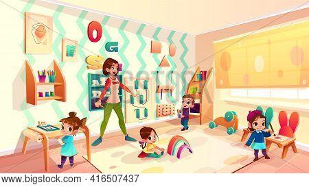 Female Preschool Nursery Nurse, Kindergarten Teacher Playing With Children In Modern, Equipped Class