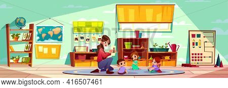 Female Teacher Of Montessori Kindergarten Or Pre-primary School Studying Alphabet Letters With Group