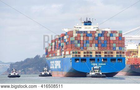 Oakland, Ca - Apr 3, 2021: Multiple Tugboats Assist Cargo Ship Cosco Europe To Maneuver Into The Por
