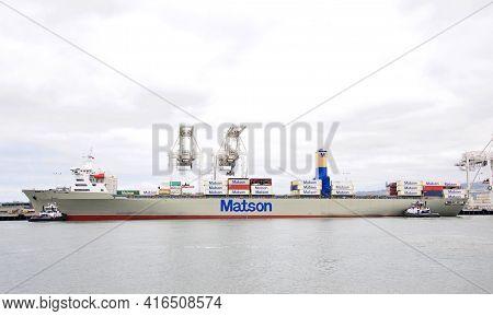 Oakland, Ca - Apr 5, 2021: Multiple Tugboats Assist Matson Cargo Ship Manoa To Maneuver Sideways To