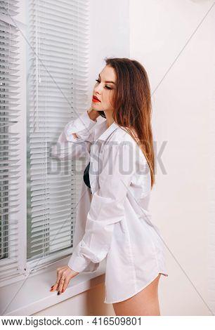 Cute Fashionable Young Woman Wearing A White Mens Shirt. Beautiful Sexy Girl Posing In White Shirt,