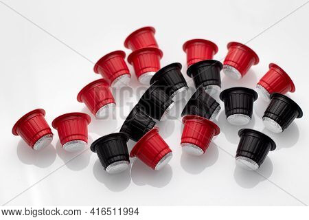 Capsules For Coffee Machine. Espresso Coffee Capsules Or Coffee Pods On White Table