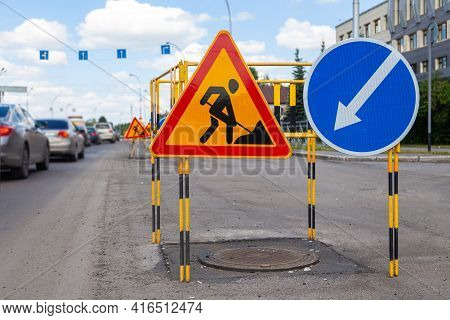 Asphalt Road Repairs, Yellow Warning Triangle Signs About Road Works And Bypass Directions