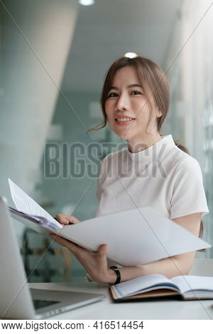 Positive Beautiful Woman Happy With Her Job And Work From Home. Business, Account, Finance, Tax Conc