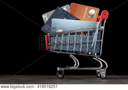 Clarksburg,md, Usa 04-06-2021: A Shopping Cart Filled With Different Types Of Credit Cards Belonging