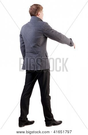 back view of businessman in coat reaches out to shake hands. Rear view people collection. backside view of person. Isolated over white background.