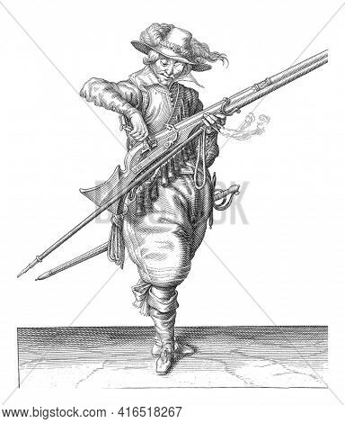 A Soldier, Full-Length Pour powder from a powder bottle into the pan (the powder container) of a musket, vintage engraving.