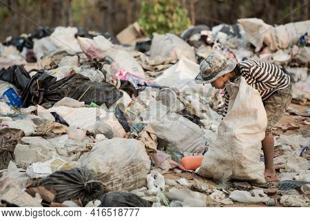 A Sad Child Is Working At A Garbage Dump, Concepts Of Child Labor And Human Trafficking.