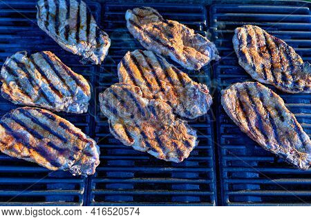 Evening Bbq Of Tenderloin Meat On Grill