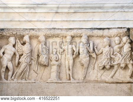 Bas-relief on stone wall of temple in Pergamon, Turkey. UNESCO world heritage site