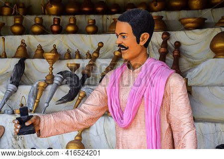Stock Photo Of 30 To 40 Year Old Indian Villager Statue Wearing Traditional Cloths And Selling Utens