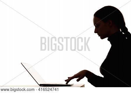 Woman Silhouette. Online Learning. Distance Education. Dark Contrast Profile Shape Portrait Of Smart