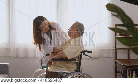 Female Nurse Doctor Wear White Uniform Cardiologist Examining Patient Senior Or Elderly Old Man Duri