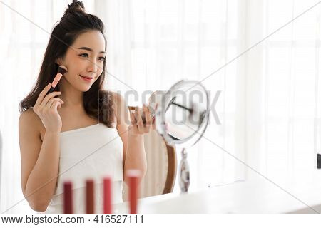 Smiling Of Young Beautiful Pretty Asian Woman Clean Fresh Healthy White Skin Looking At Mirror.asian