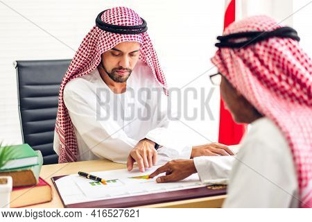 Successful Of Two Arab Business People Working With Laptop Computer.creative Arabic People Planning