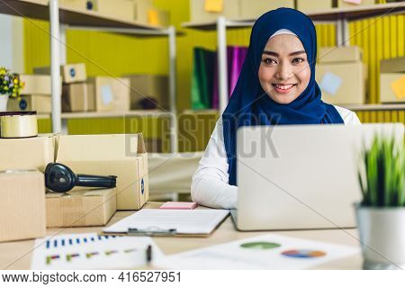 Portrait Of Smiling Beautiful Muslim Owner Asian Woman Freelancer Sme Business Online Shopping Worki