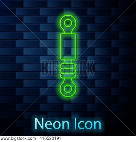 Glowing Neon Line Shock Absorber Icon Isolated On Brick Wall Background. Vector