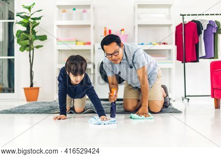 Father Teaching Asian Kid Little Boy Son Use Disinfectant Spray Bottle Cleaning And Washing Floor Wi