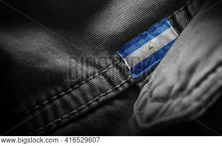 Tag On Dark Clothing In The Form Of The Flag Of The Nicaragua