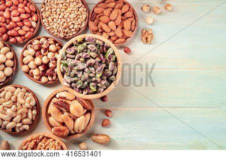 Nuts Design Layout With Copy Space. Pistachios, Cashews, Pine Nuts Etc