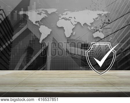 Security Shield With Check Mark Flat Icon On Wooden Table Over Black And White World Map, City Tower