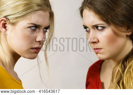 Conflict, Bad Relationships, Friendship Difficulties. Two Young Women Face To Face Having Argument.