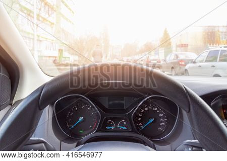 View Of The Steering Wheel With Speedometer And Tachometer Illuminated In The Sun, Travel By Car