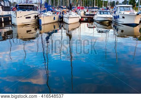 Moored Sailboats On A Pier Calm Early Morning. Summer Sailing Vacations.