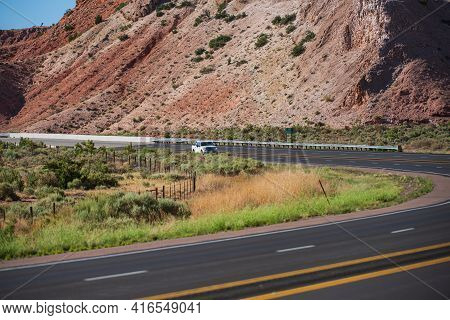 View Of Highway Road Running Through The Barren Scenery Of The American Southwest With Extreme Heat