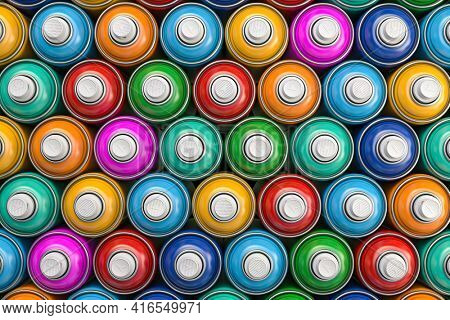 Top view of colorful graffity spray paint cans or bottles of aerosol. 3d illustration